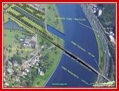 """<font color=""""blue""""><font size=""""+1""""> la construction d un pont au Nord - Celui-ci sera construit depuis la rive gauche de la Meuse pour aboutir au niveau de l actuel parking le long de l autoroute E25. Il permettra de relier la plate-forme au réseau autoroutier.</font></font>"""